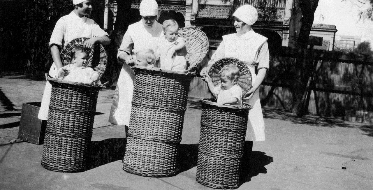 Historical image with nurses and babies in baskets